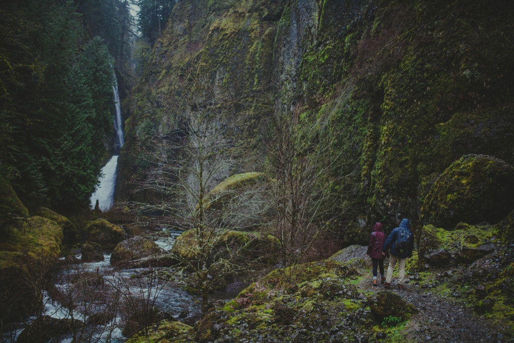couple hiking pacific northwest wahclella falls by Marcela Pulido Portland Wedding Photographer