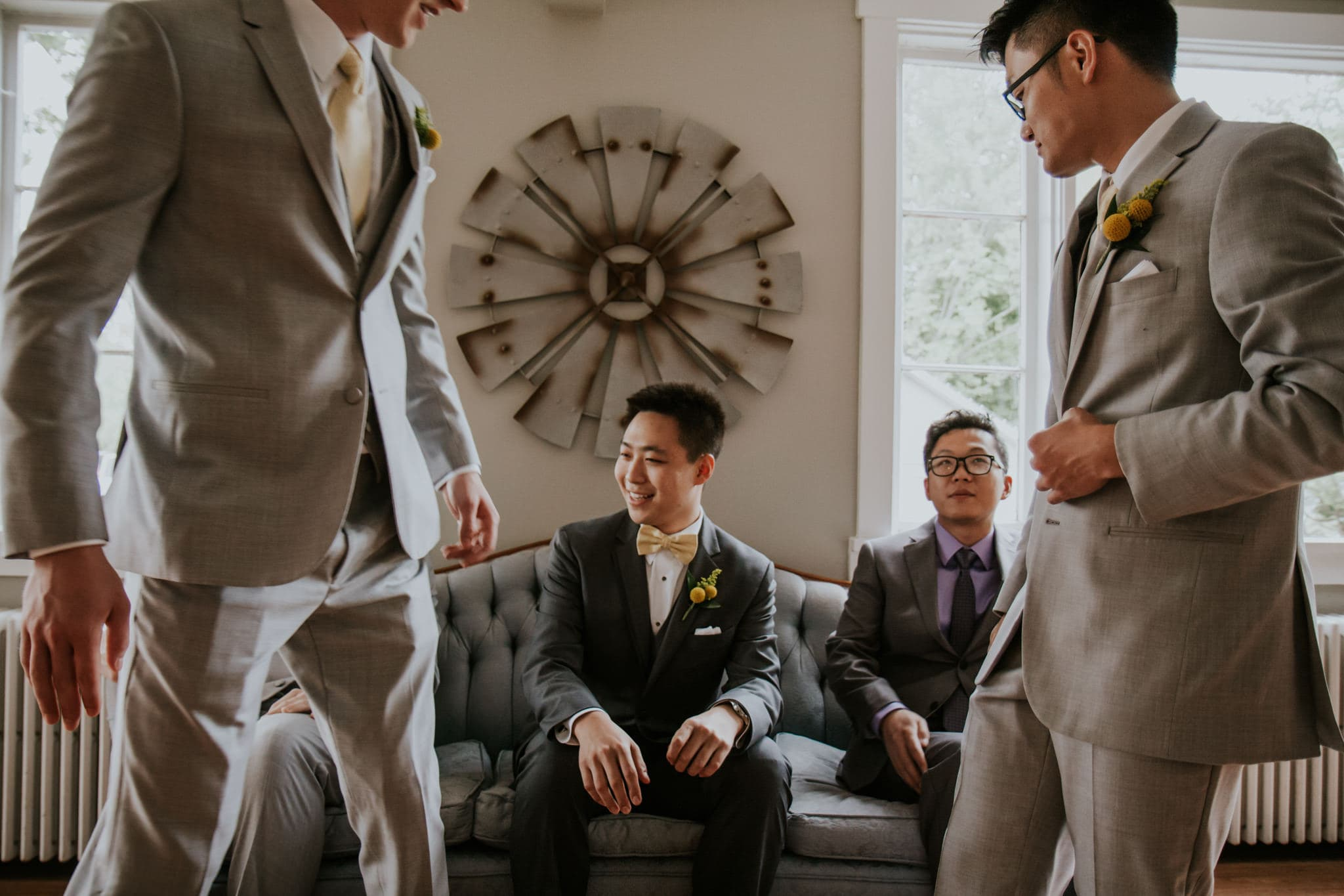 groomsmen sitting on fancy sofa Mustard Seed Gardens Wedding Photography