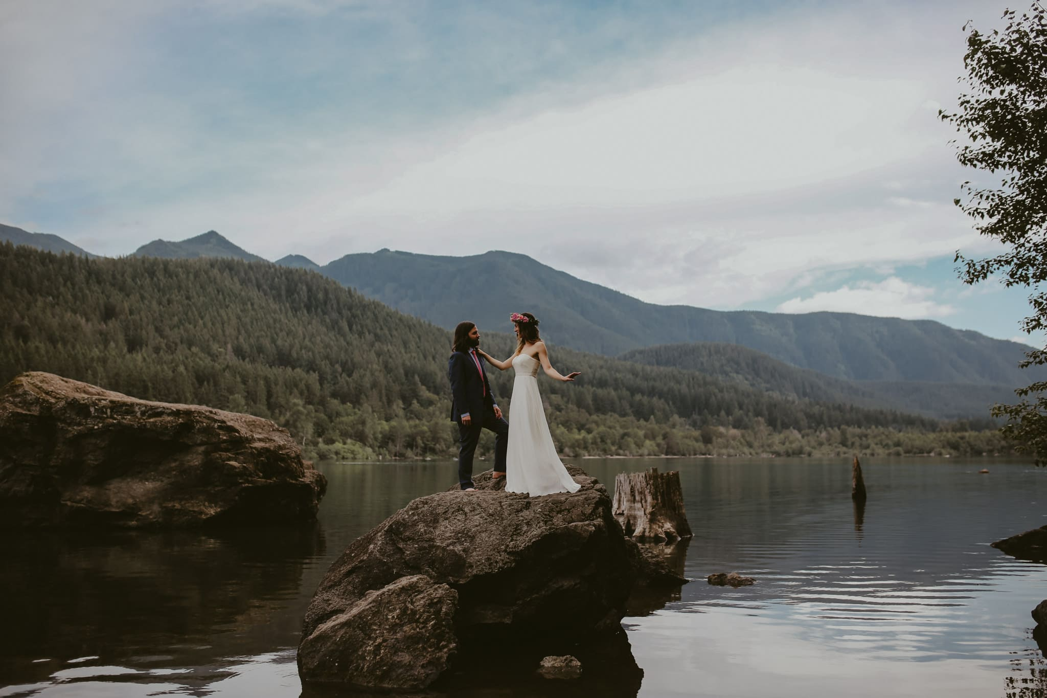 dainty bride and groom on lake Rattlesnake Lake Wedding Marcela Pulido Photography