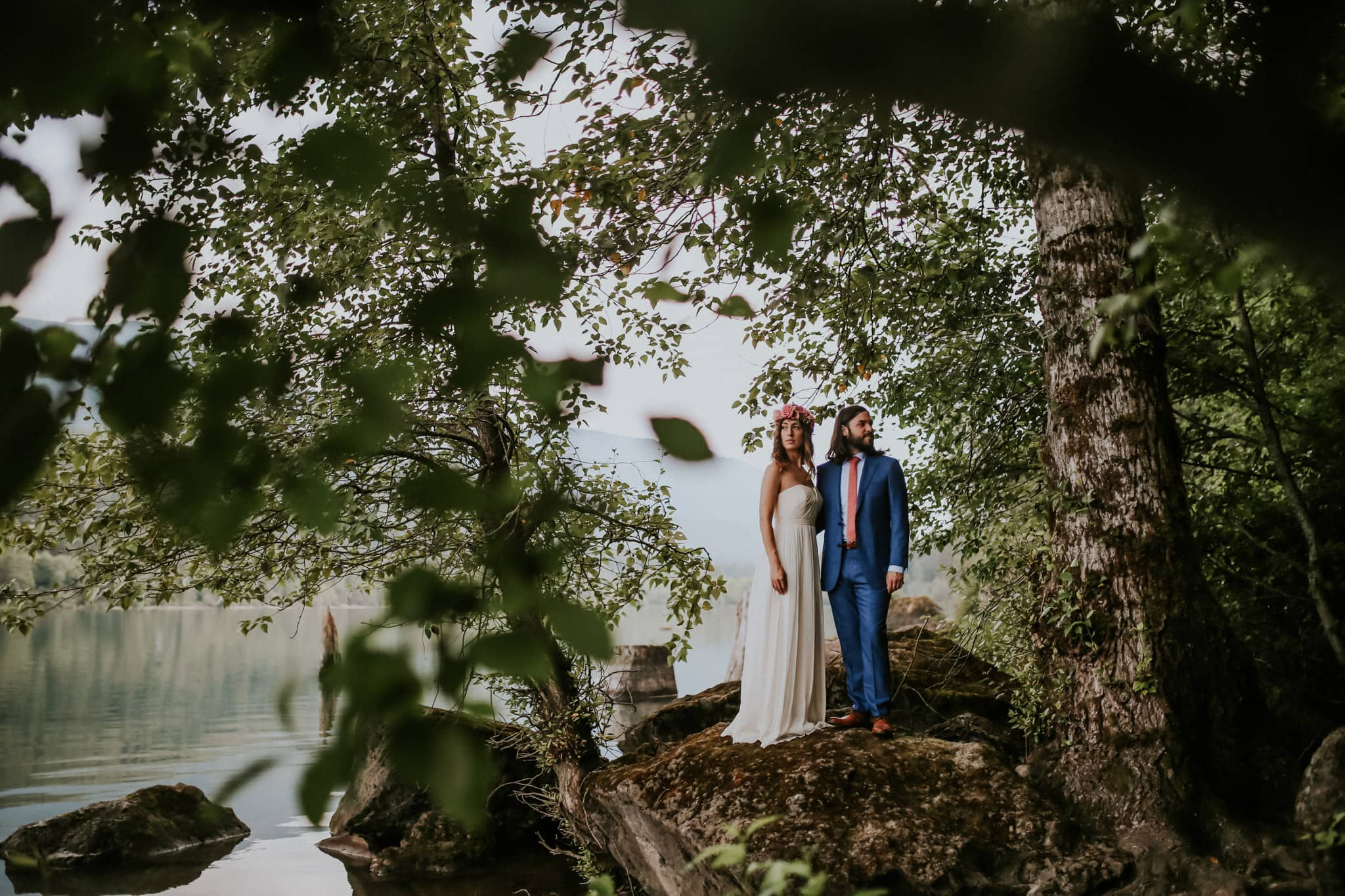 bride and groom on rock at Rattlesnake Lake Wedding Marcela Pulido Photography