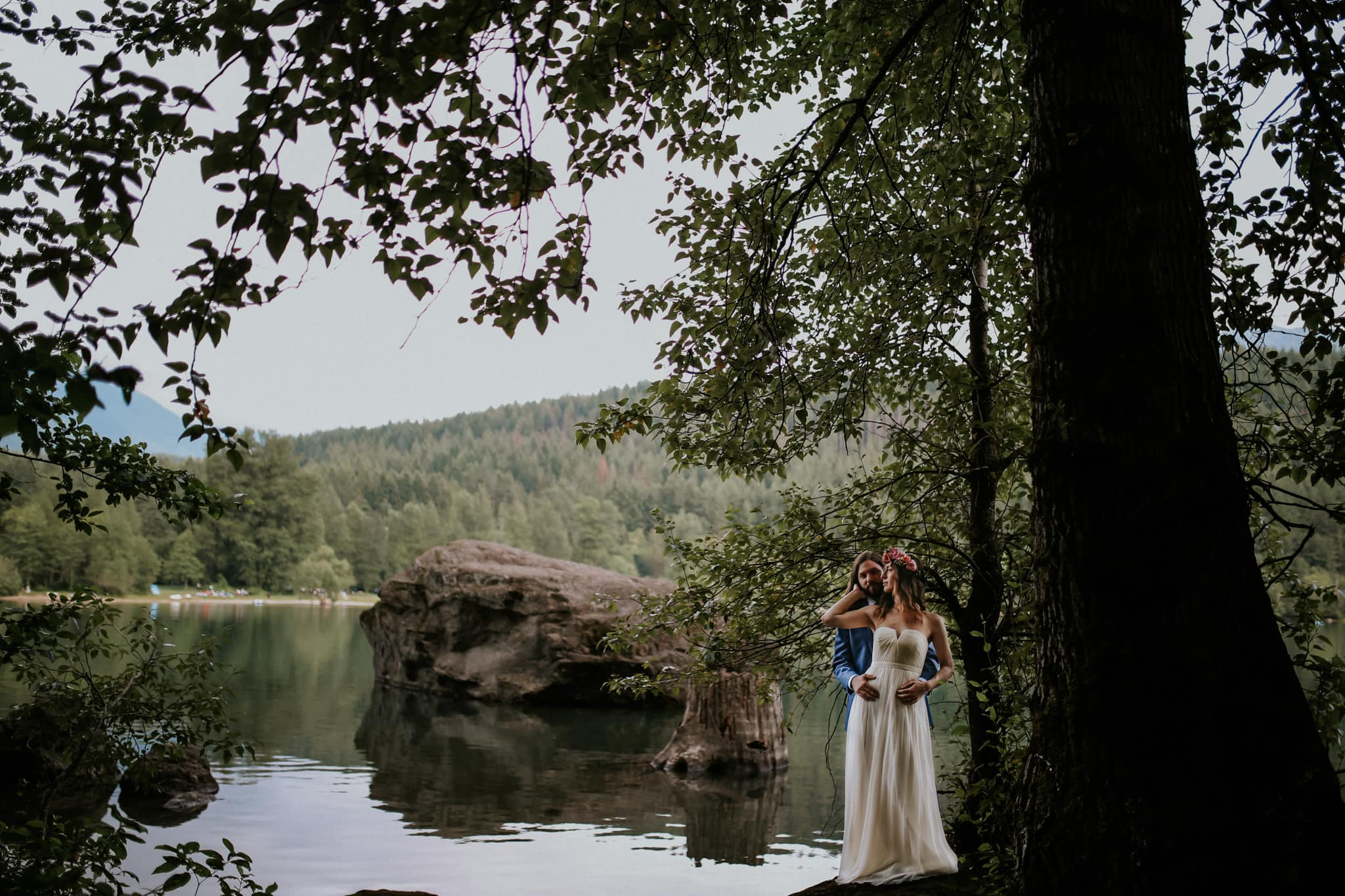 bride and groom on lake Rattlesnake Lake Wedding Marcela Pulido Photography