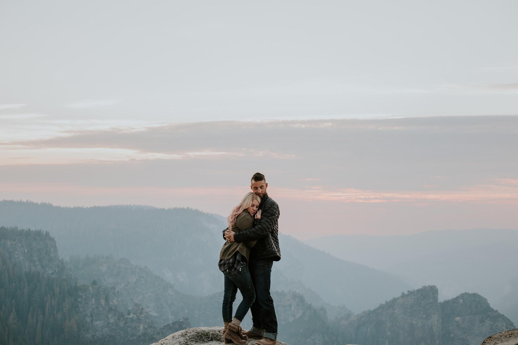 sunset at Taft Point hold her close Yosemite Engagement Photographer