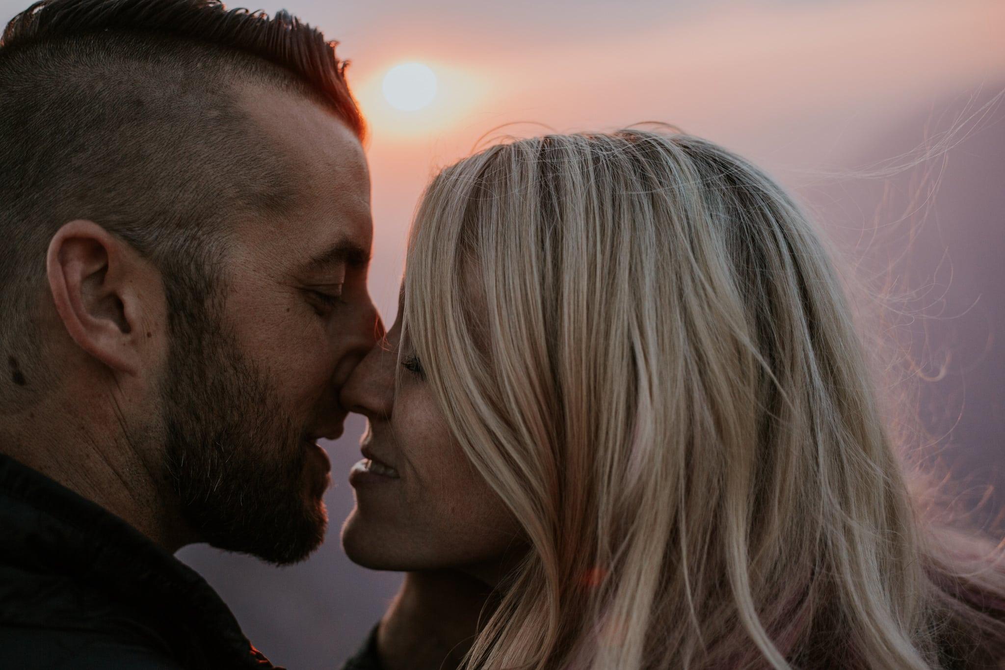 close up kiss sunset at Taft Point Yosemite Engagement Photographer