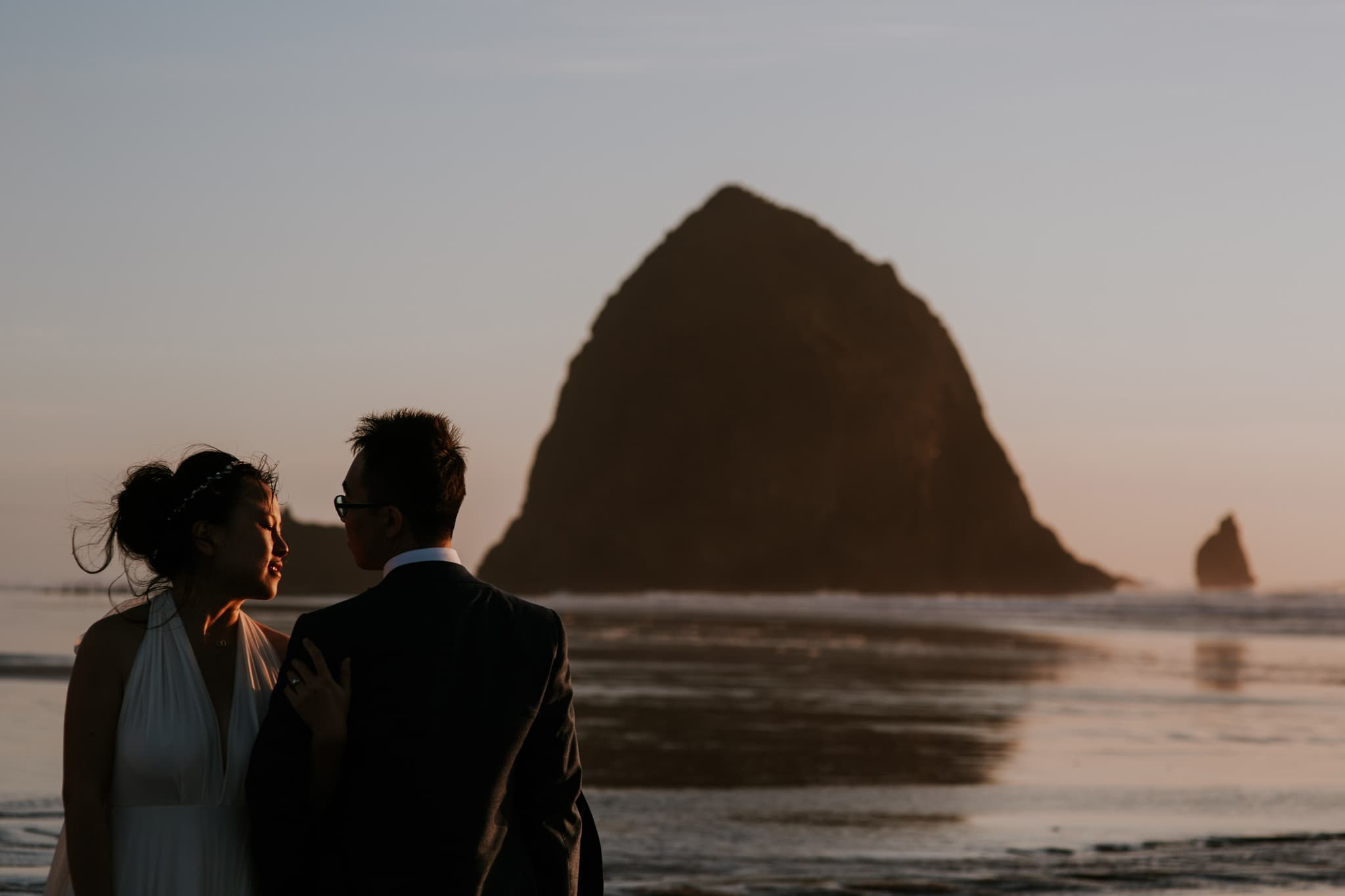 haystack rock cannon beach oregon coast wedding portraits Portland Wedding Photographer Marcela Pulido