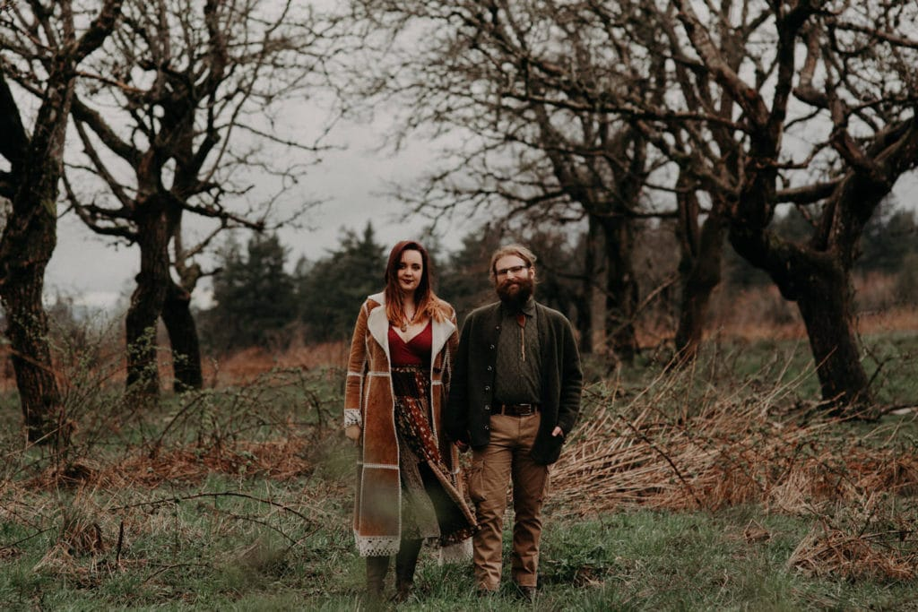 cute boho hippie couple in forest pnw pose Powell Butte Portland Engagement Photographer by Marcela Pulido Photography Portland Wedding Photographer