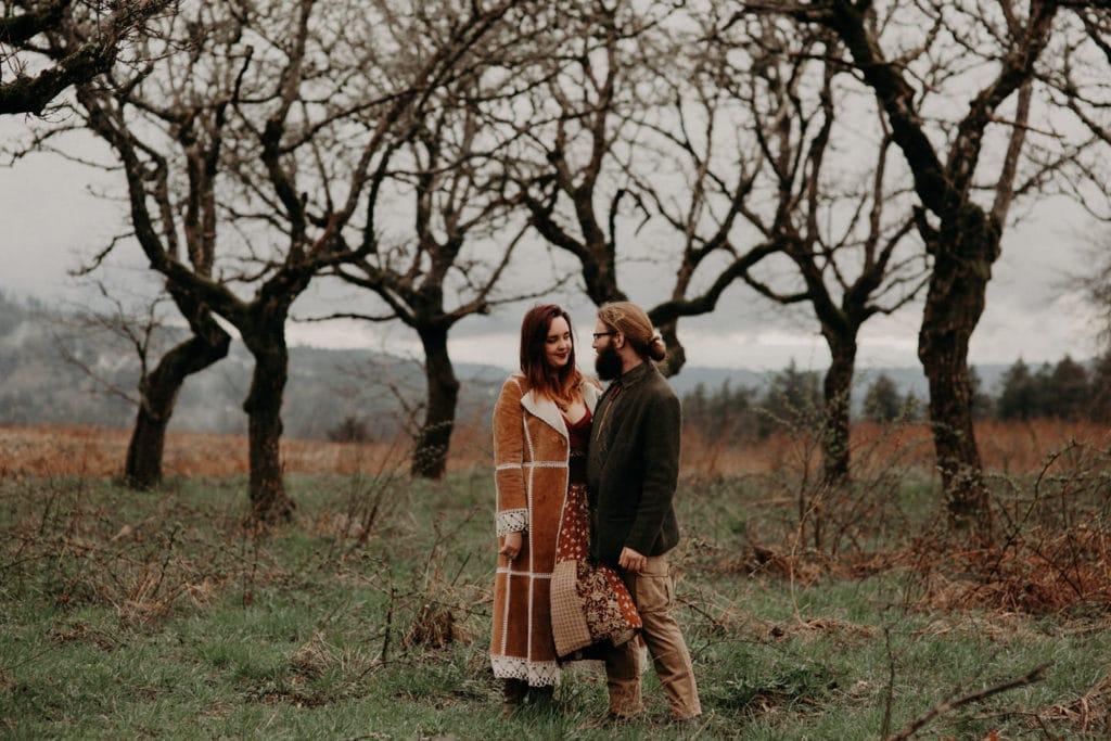 cute hippie couple in forest Powell Butte Portland Engagement Photographer by Marcela Pulido Photography Portland Wedding Photographer