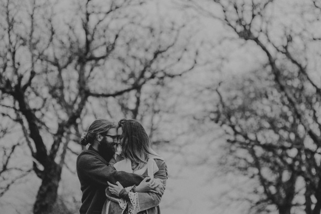 black and white hippie couple in forest Powell Butte Portland Engagement Photographer by Marcela Pulido Photography Portland Wedding Photographer