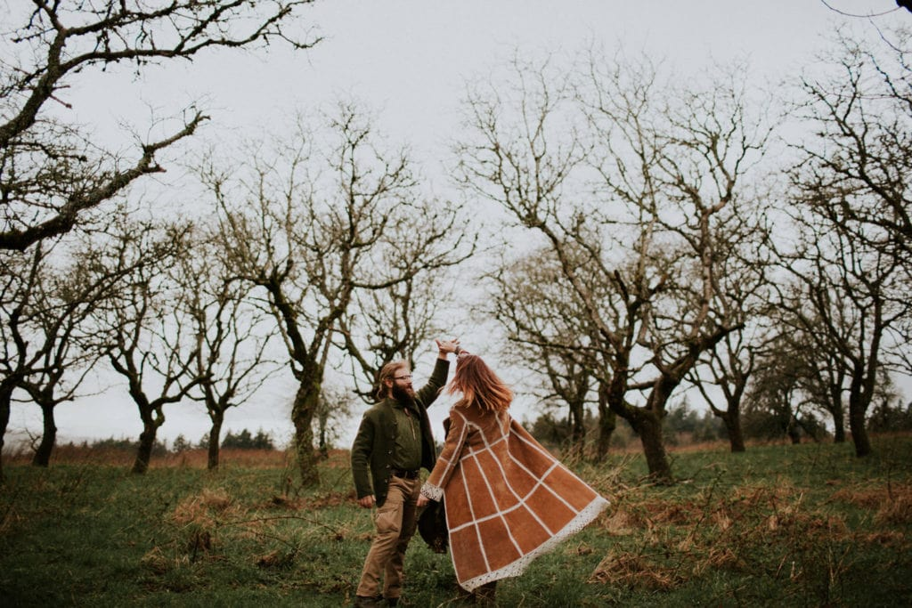 cute boho hippie couple dance in forest Powell Butte Portland Engagement Photographer by Marcela Pulido Photography Portland Wedding Photographer
