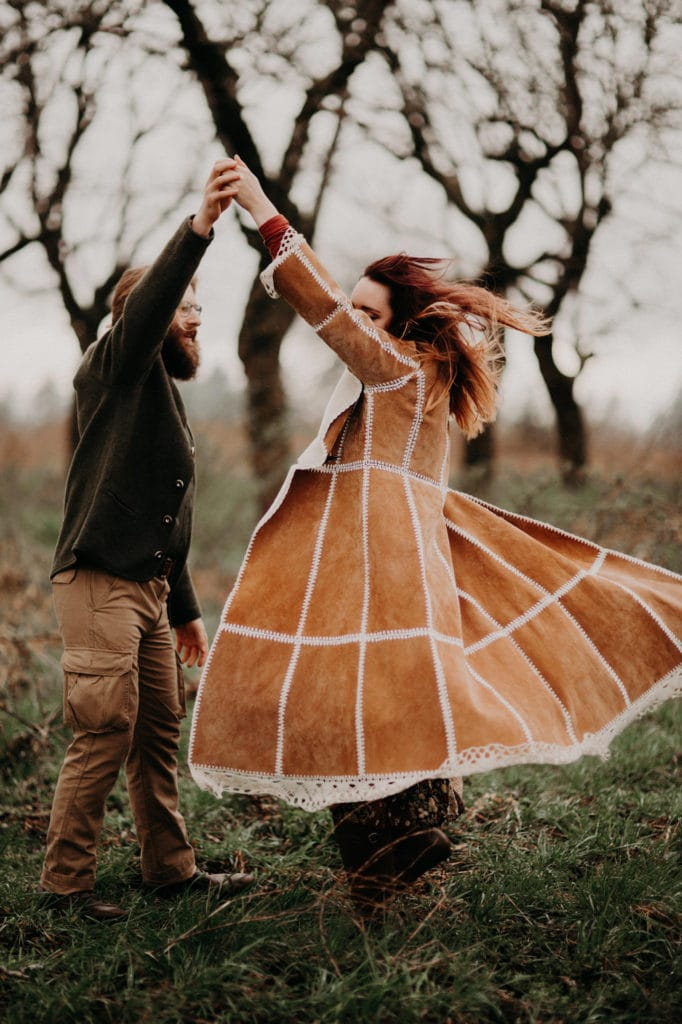 give her a spin! in the forest Powell Butte Portland Engagement Photographer by Marcela Pulido Photography Portland Wedding Photographer