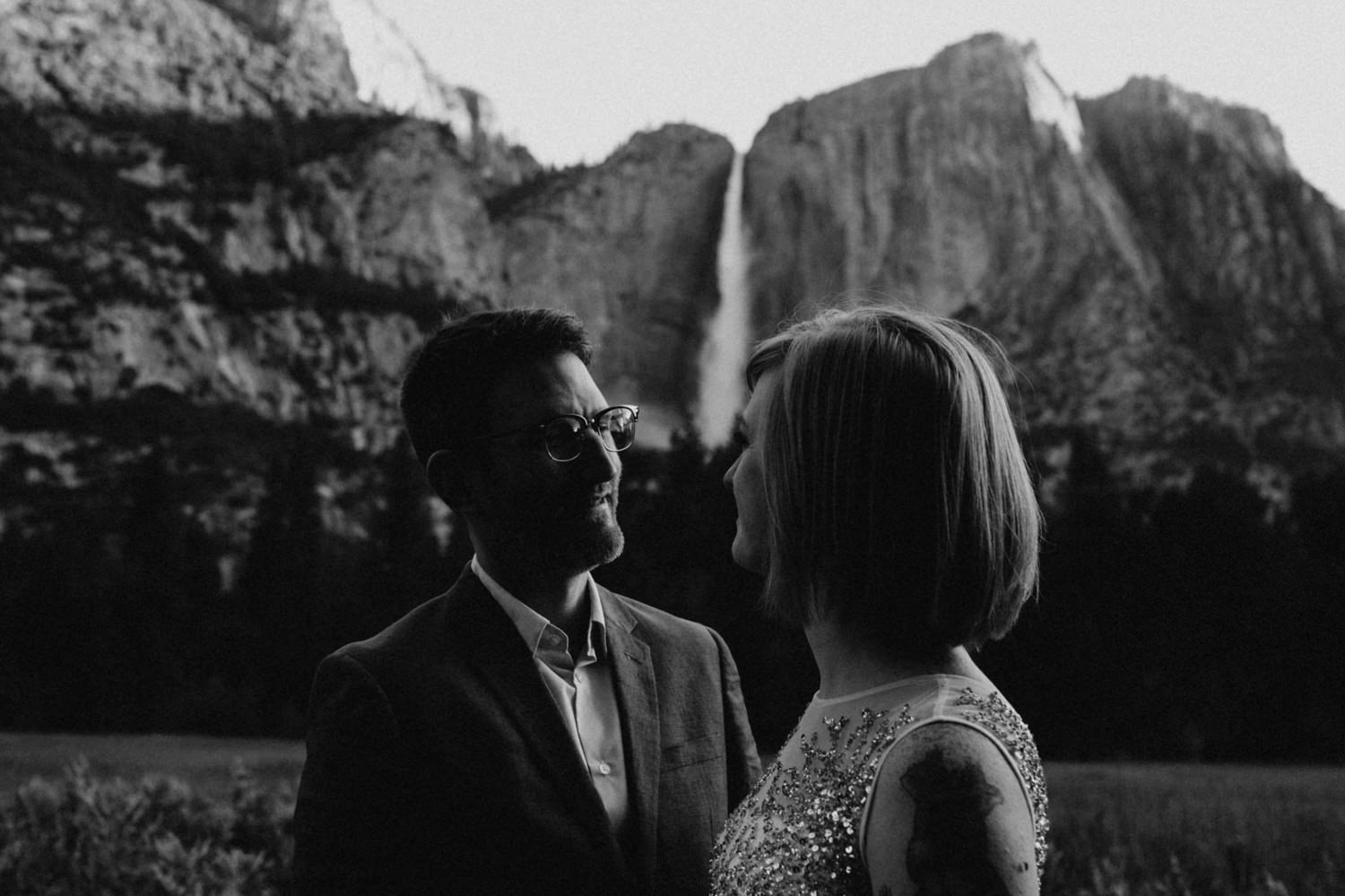 black and white Anjali and Ben in front of Yosemite Falls