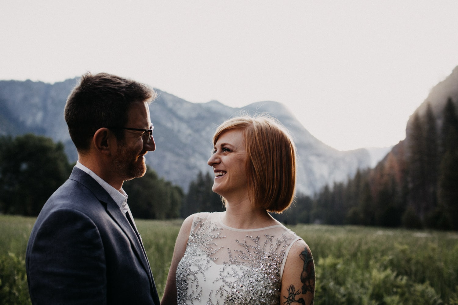 Anjali and Ben in a meadow for their sunrise Yosemite Elopement