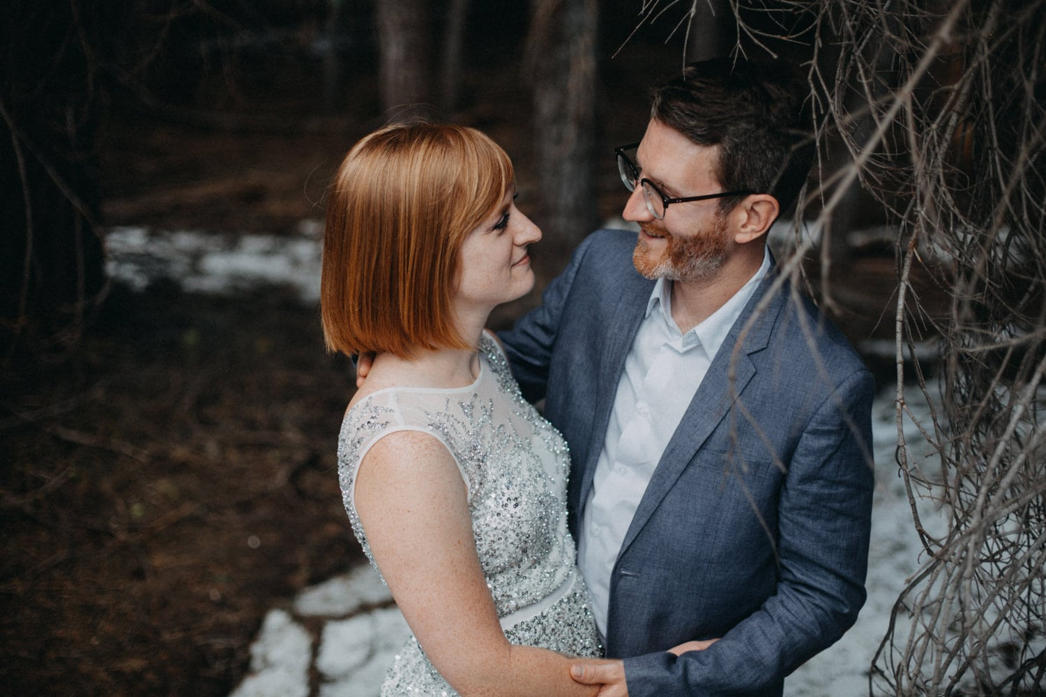 Anjali and Ben snow in June trail to Taft Point in Yosemite National Park for their elopement