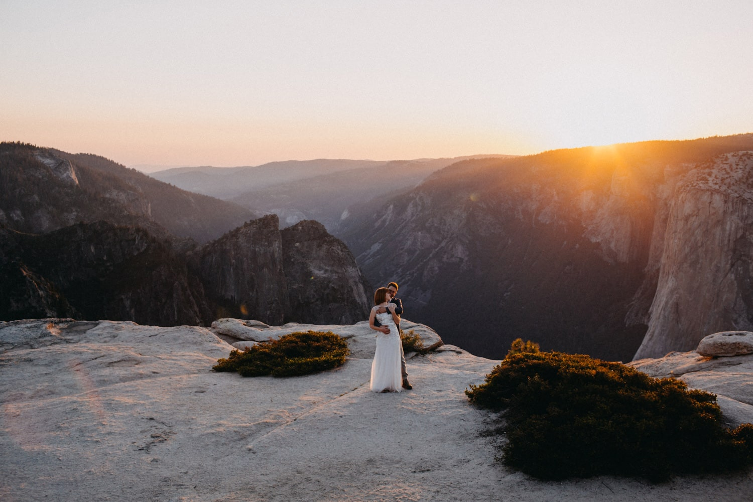 Ben holding Anjali close at sunset at Taft Point for their Yosemite elopement