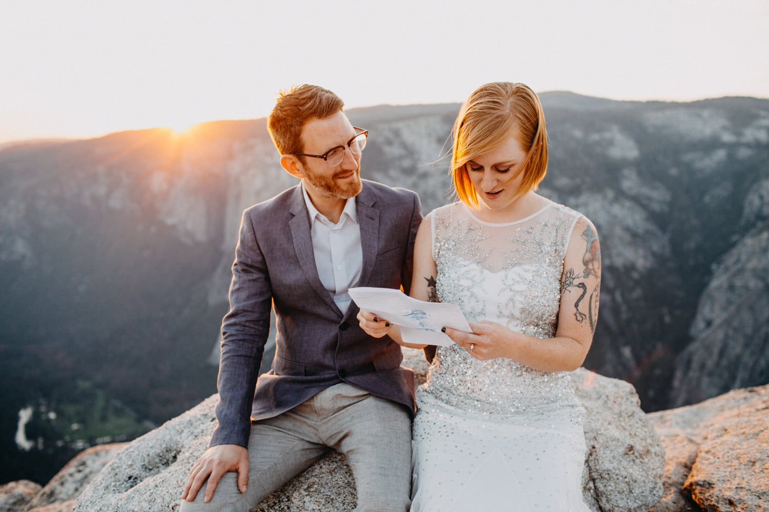 Anjali and Ben exchanging vows at sunset at Taft Point for their Yosemite Elopement