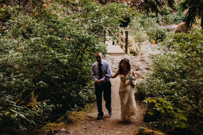father walks bride down aisle at Wahclella Falls Oregon Columbia River Gorge elopement