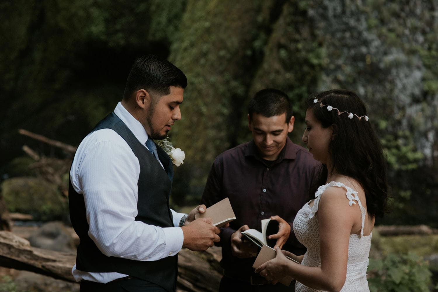 reading their vows in front of Wahclella Falls Oregon Columbia River Gorge elopement