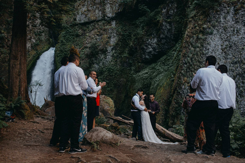 first kiss as newlyweds at Wahclella Falls Oregon Columbia River Gorge elopement