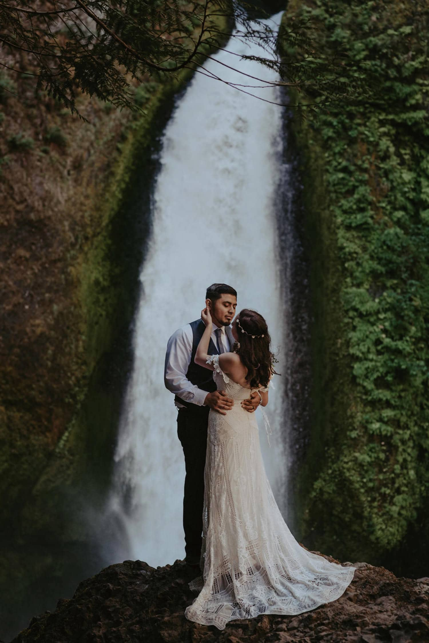 newlywed couple intimate in front of Wahclella Falls Oregon Columbia River Gorge elopement