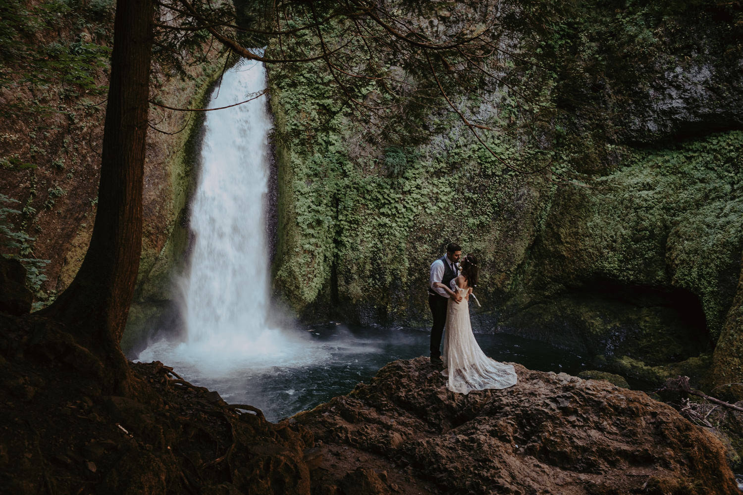 newlyweds in front of Wahclella Falls Columbia River Gorge elopement
