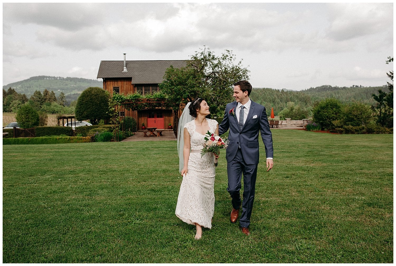 cute interracial couple walking on lawn at beacon hill wedding
