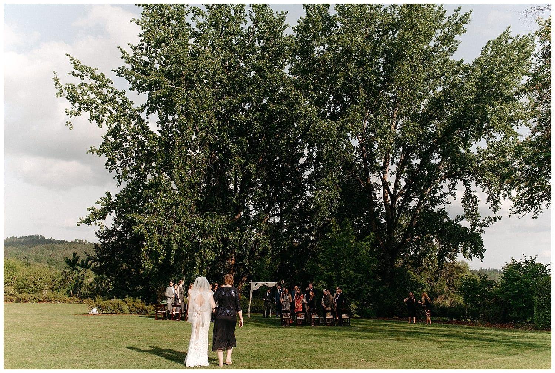 bride walking down the aisle oregon winery beacon hill wedding