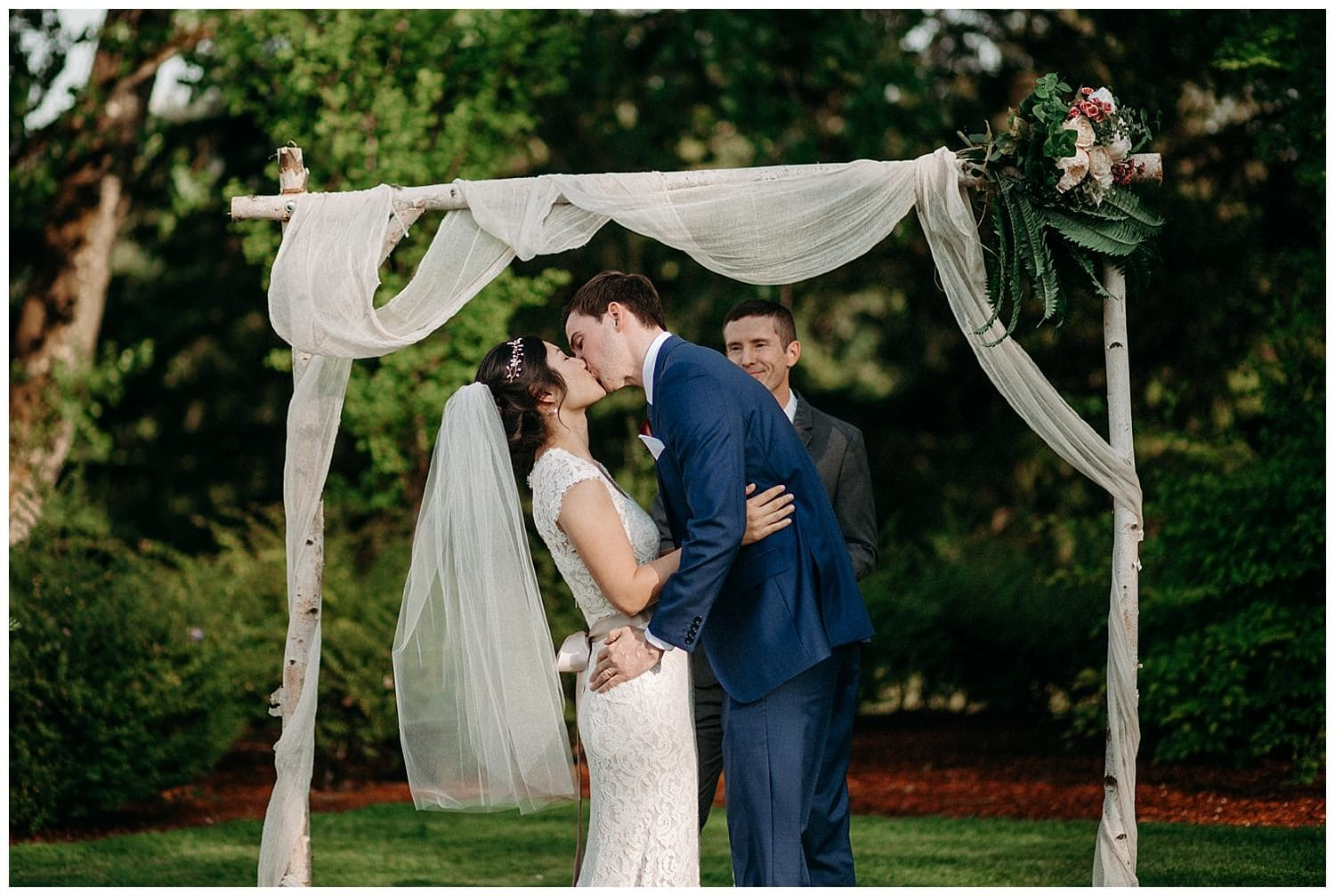 couple's first kiss at beacon hill wedding