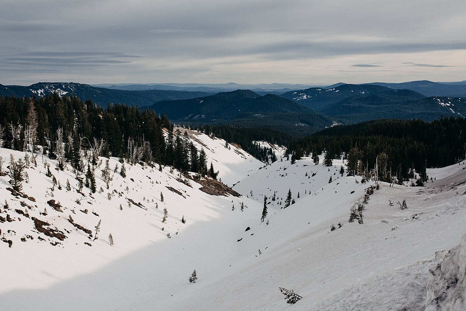 view from mt hood towards snow capped peaks